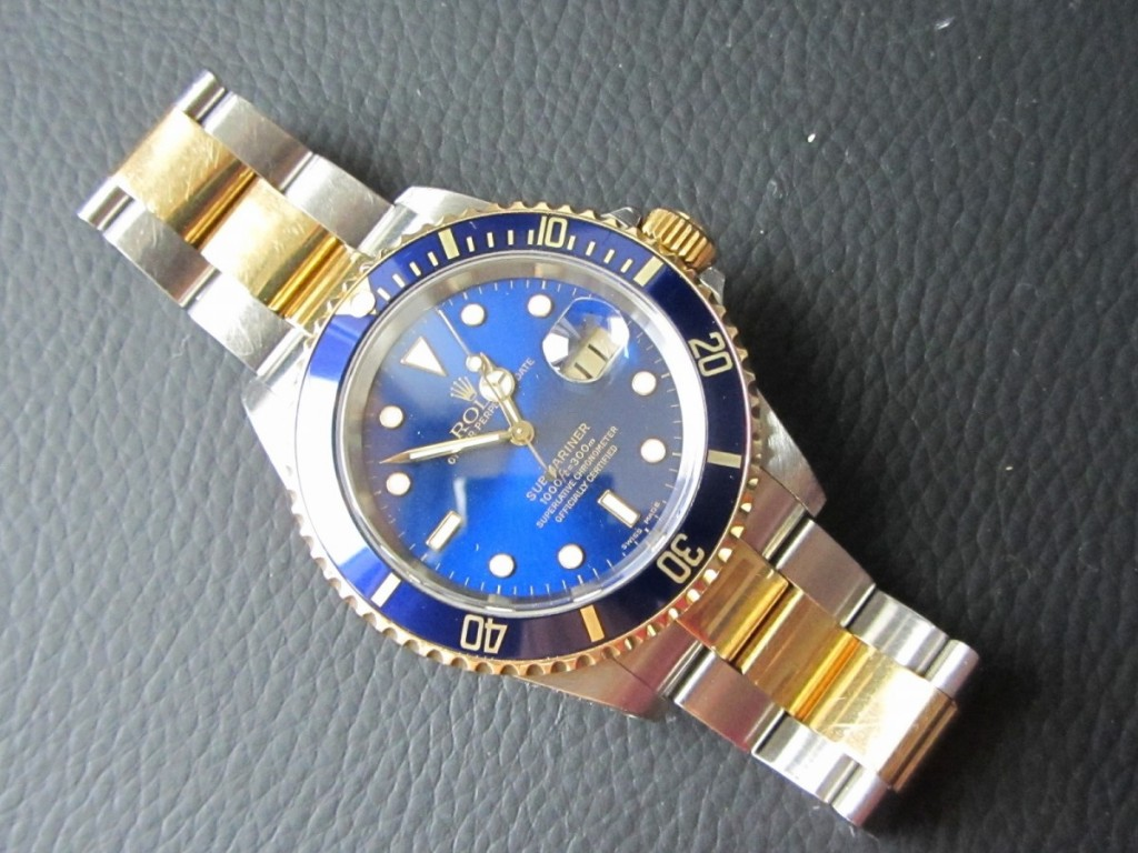 The Rolex Submariner Bi-Metal 16613 Blue Dial Stunning piece.